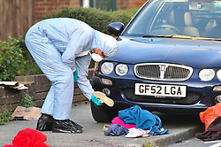 © Licensed to London News Pictures. 19/08/2018<br /> New Eltham, UK. Police forensics examine blood covered clothing at the scene of a Hammer attack on two women in New Eltham, south east London. Police are currently searching for 27 year old Joe Xuereb in connection with the attack. <br /> Photo credit: Grant Falvey/LNP