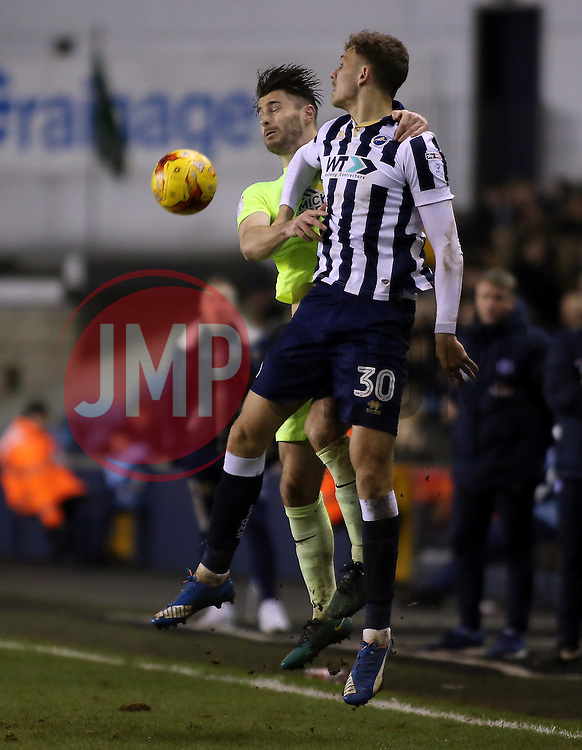 Andrew Hughes of Peterborough United challenges Harry Smith of Millwall in the air - Mandatory by-line: Joe Dent/JMP - 28/02/2017 - FOOTBALL - The Den - London, England - Millwall v Peterborough United - Sky Bet League One