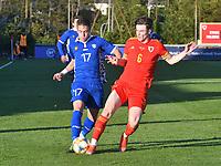 Football - 2023 UEFA U21 Championship - Qualifying - Group E - Wales vs Moldova - Steboneath Park, Llanelli<br /> <br /> Motpan Moldova tackled by Morgan Boyes Wales<br /> <br /> COLORSPORT/WINSTON BYNORTH