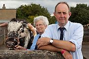 Eileen Hallifield and her husband, Richard, own Dunstall Hector, a two-year-old Longhorn bull. He has had conditioner added to the last lot of water, to keep his coat from drying out. 'They come to like the grooming because it makes their coat so nice and clean,' Hallifield says. 'It would feel nice, wouldn't it? They are like one of the family, although they are not a pet like a cat or a dog because eventually they have to go,' Hallifield adds. Dunstall Hector has since been sold for breeding, but the Hallifields  will have a framed portrait of him in their living-room. The hairdryers are out and the shampoo is flowing at the Great Yorkshire Show, one of Britain's biggest agricultural shows. Its famous for its competitive displays of livestock. The event, established in 1837, attracts over 125 000 visitors a year and has over 10 000 entries to its pedigree competitions ranging from pigeons and rabbits to bulls and shire horses. At the heart of the show is the passion of the exhibitors who spend hundreds of hours ( and pounds)  training, preparing and grooming their animals.