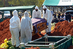 South Africa  - Johannesburg – Covid funeral.  Nathan van Rooi who died of covid-19 related complications is buried at Wespark cemetery on Thursday. The family followed the restrictions imposed by authorities and could not carry the coffin or close the grave.  He was buried a day after what would have been his 58th birthday. PPE's protective gear . Picture: Timothy Bernard/African News  Agency(ANA)