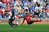 Cardiff city's Fraizer Campbell watches as his shot at goal goes just wide of the post.  Barclays Premier League match, Cardiff city v Newcastle Utd  at the Cardiff city stadium in Cardiff, South Wales on Saturday 5th Oct 2013. pic by Andrew Orchard, Andrew Orchard sports photography,