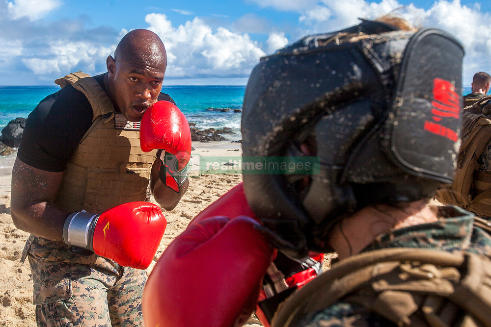 U.S. Marine Corps Staff Sgt. Nathaniel McDonald, the motor transport operations chief with Combat Logistics Battalion 3, prepares to spar during the Marine Corps Martial Arts Instructors Course's (MAIC) culmination, Marine Corps Base Hawaii, Sept. 27, 2018. MAIC is a knowledge driven course that educates students on proper techniques and to properly instruct other Marines to advance their belt level. (U.S. Marine Corps photo by Lance Cpl. Matthew Kirk)
