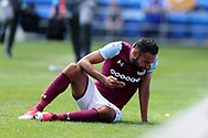 Ahmed Elmohamady of Aston Villa spits blood as he waits for treatment after collision with Cardiff goalkeeper Neil Etheridge and defender Joe Bennett. EFL Skybet championship match, Cardiff city v Aston Villa at the Cardiff City Stadium in Cardiff, South Wales on Saturday 12th August 2017.<br /> pic by Andrew Orchard, Andrew Orchard sports photography.