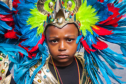 London, August 24th 2014. A young boy takes his role in the carnival seriously, as revellers prepare to participate in 2014's Notting Hill Carnival in London, celebratingWest Indian and other cultures, and attracting hundreds of thousands to Europe's biggest street party.