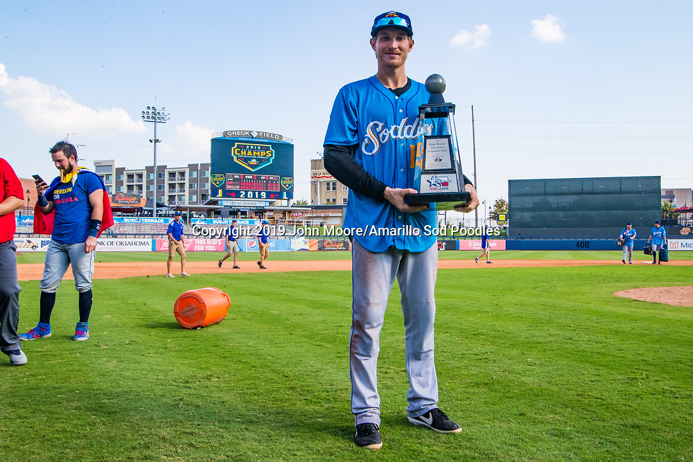 Amarillo Sod Poodles outfielder Taylor Kohlwey (15) poses with the trophy after the Sod Poodles won against the Tulsa Drillers during the Texas League Championship on Sunday, Sept. 15, 2019, at OneOK Field in Tulsa, Oklahoma. [Photo by John Moore/Amarillo Sod Poodles]
