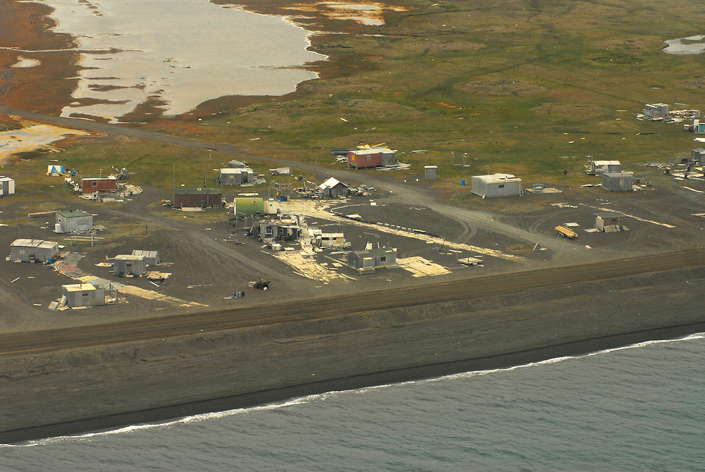 Alaska, Barrow. Aerial view of Pigniq, a summer duck hunting place with cabins, by the shore of the Arctic Ocean. July 2007