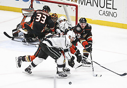 November 7, 2017 - Los Angeles, California, U.S - Los Angeles Kings defenseman Alec Martinez (27) and Anaheim Ducks defenseman Sami Vatanen (45) fight for the puck during a 2017-2018 NHL hockey game in Anaheim, California on Nov. 7, 2017. Los Angeles Kings won 4-3 in overtime. (Credit Image: © Ringo Chiu via ZUMA Wire)