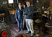 Michael Leveille, left, and Kevin Marcinkus of KM Lifestyle Manufacturing design and handcraft electrical and mechanical components for antique auto and radio collections on Wednesday, September 28, 2016. <br /> <br /> <br /> <br /> T&G Staff/Christine Hochkeppel