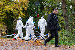 © Licensed to London News Pictures. 24/10/2020. Watlington Hill, UK. Forensic investigators walk past an area cordoned off with police tape as they make there way down a path at the Watlington Hill National Trust Estate. A murder investigation has been launched by Thames Valley Police after the body of a woman in her sixties was located in woodland in the Watlington Hill National Trust Estate at approximately 5:53pm on Friday 23/10/2020. Photo credit: Peter Manning/LNP