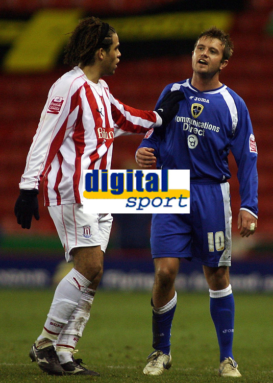 """Photo: Paul Thomas.<br /> Stoke City v Cardiff City. Coca Cola Championship. 28/11/2006.<br /> <br /> Darel Russell (L) of Stoke tells Cardiff's Stephen McPhail to """"leave it"""" and just head back to the dressing room after being sent off."""