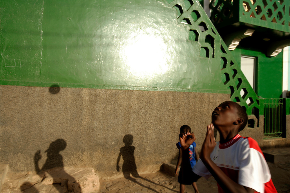 Children playing football on Vila do Maio (Maio's Village) streets. Cape Verde population is very young and the country is known for the good use of international aid, specially in sending its students  abroad on scholarship programs.