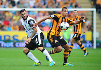 Hull City's Jake Livermore vies for possession with Norwich City's Bradley Johnson<br /> <br />  (Photo by Chris Vaughan/CameraSport) <br /> <br /> Football - Barclays Premiership - Hull City v Norwich City - Saturday 24th August 2013 - Kingston Communications Stadium - Hull<br /> <br /> © CameraSport - 43 Linden Ave. Countesthorpe. Leicester. England. LE8 5PG - Tel: +44 (0) 116 277 4147 - admin@camerasport.com - www.camerasport.com