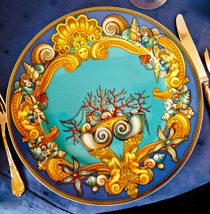 Nymphs, seashells and coral adorn a splendid plate at the opulently restored restarant in the Versace Mansion on Miami Beach's Ocean Drive, when the place was under the management of Barton G.
