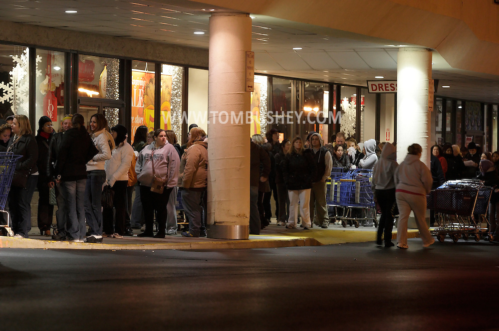 Town of Wallkill, New York - People wait in line to get into a Toy R Us store on Thanksgiving night to get an early start on their Black Friday shopping on Nov. 25, 2010. The toy store opened at 10 p.m. The stores the people are standing in front of did not open until Friday morning.