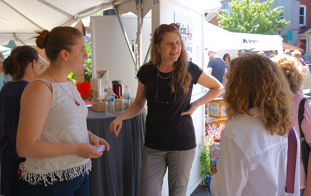 Karen Weber of Art Plus Gallery talks with guests at plein aire art show, West Reading, Berks Co.,
