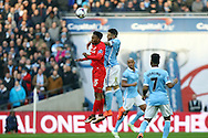 Daniel Sturridge of Liverpool (L) and Nicolas Otamendi of Manchester City. jump for the ball. Capital One Cup Final, Liverpool v Manchester City at Wembley stadium in London, England on Sunday 28th Feb 2016. pic by Chris Stading, Andrew Orchard sports photography.
