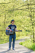 Brennan practices the guitar Friday April 27, 2018 at Cherokee Park in Louisville, Ky. (Photo by Brian Bohannon)