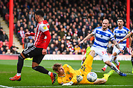 Brentford Forward Said Benrahma (21) has his shot own goal blocked by Queens Park Rangers Goalkeeper Joe Lumley (13) during the EFL Sky Bet Championship match between Brentford and Queens Park Rangers at Griffin Park, London, England on 2 March 2019.