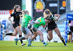 Ellie Green of Harlequins attempts a tackle on Garnet Mackinder of Exeter Chiefs - Mandatory by-line: Andy Watts/JMP - 06/02/2021 - Sandy Park - Exeter, England - Exeter Chiefs Women v Harlequins Women - Allianz Premier 15s