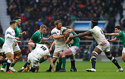 Ireland's Garry Ringrose (centre) is tackled by England's Chris Robshaw (centre left) and Maro Itoje (right) during the NatWest 6 Nations match at Twickenham Stadium, London.