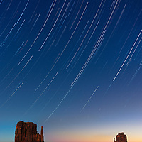 Monument Valley Mittens and star trails under light of full moon.