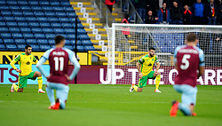 Norwich City's Grant Hanley (right) takes a knee prior to the Premier League match at Turf Moor, Burnley. Picture date: Saturday October 2, 2021.