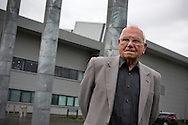 'Untitled, 2014' from the project 'The Fall and Rise of Ravenscraig' by photographer Colin McPherson.<br /> <br /> The photograph shows former Ravenscraig trade union convener and campaigner Tommy Brennan, pictured outside the Ravenscraig Regional Sports Facility, built in 2010 on the site of the former steelworks.<br /> <br /> This project, photographed in 2014, looks at the topography of the post-industrial landscape at Ravenscraig, the site until its closure in 1992 of the largest hot strip steel mill in western Europe. In its current state, Ravenscraig is one of the largest derelict sites in Europe measuring over 1,125 acres (4.55 km2) in size, an area equivalent to 700 football pitches or twice the size of Monaco. It is currently being developed with a mix of housing, retail and the home of South Lanarkshire College and the Ravenscraig Regional Sports Facility.