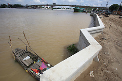 New river embankment construction to provide protection from floodwaters on a branch of the Mekong River in the Delta, Can Tho, Vinh Long Province, Vietnam