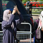 London, UK. 27 June 2019. UK Weather - burqa woman taking a selfies at the Hottest week in June 2019 at Buckingham Palace, London, UK