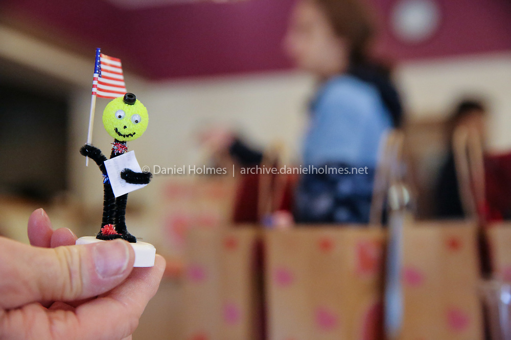 (1/12/19, MILFORD, MA) A pipe cleaner figure with an American flag gets dropped into a care package during the Thanks to Yanks care package collection event the at Milford Italian Veterans Post 5 in Milford on Saturday. [Daily News and Wicked Local Photo/Dan Holmes]