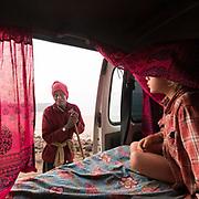 A man looks inside a camping car - camper van.