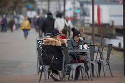 © Licensed to London News Pictures.  30/04/2021. Southend-on-Sea, UK. Member of the public sit along Thames Estuary in Southend-on-Sea, Essex. Forecasts predict chilly bank holiday weekend with showers which may turn heavy at times during the afternoon, most likely near the south coast. Photo credit: Marcin Nowak/LNP