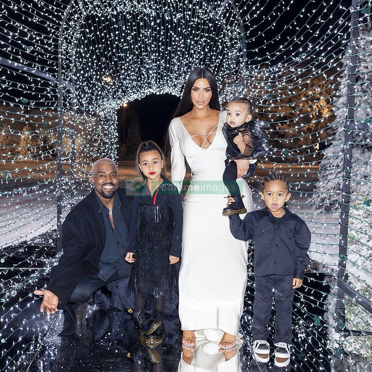 """Kim Kardashian releases a photo on Twitter with the following caption: """"""""❄️  Christmas 2018 ❄️"""""""". Photo Credit: Twitter *** No USA Distribution *** For Editorial Use Only *** Not to be Published in Books or Photo Books ***  Please note: Fees charged by the agency are for the agency's services only, and do not, nor are they intended to, convey to the user any ownership of Copyright or License in the material. The agency does not claim any ownership including but not limited to Copyright or License in the attached material. By publishing this material you expressly agree to indemnify and to hold the agency and its directors, shareholders and employees harmless from any loss, claims, damages, demands, expenses (including legal fees), or any causes of action or allegation against the agency arising out of or connected in any way with publication of the material."""