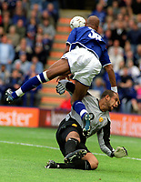 Tim Howard (Utd goalkeeper) collides with Marcus Bent (Leicester) Leicester City v Manchester United. 27/9/03. Credit Andrew Cowie, Digitalsport