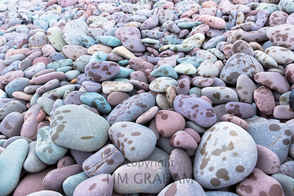 Raindrops on pebbles as rain starts to fall on Bossington Beach, Somerset, UK