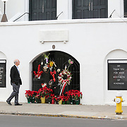 Charleston, SC - January 4, 2017: A man stops to observe the makeshift memorial in front of Mother Emanuel AME Church in downtown Charleston. A few blocks away at the federal courthouse, jurors are hearing testamony in the penalty phase of the Dylann Roof trial.