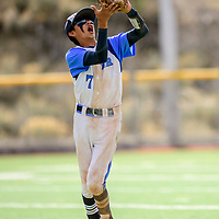 Window Rock Scout Rainer Morgan (7) catches a line drive Wingate Bear hit from shortstop during the Wingate Baseball Slam tournament at Ford Canyon Park in Gallup Friday.