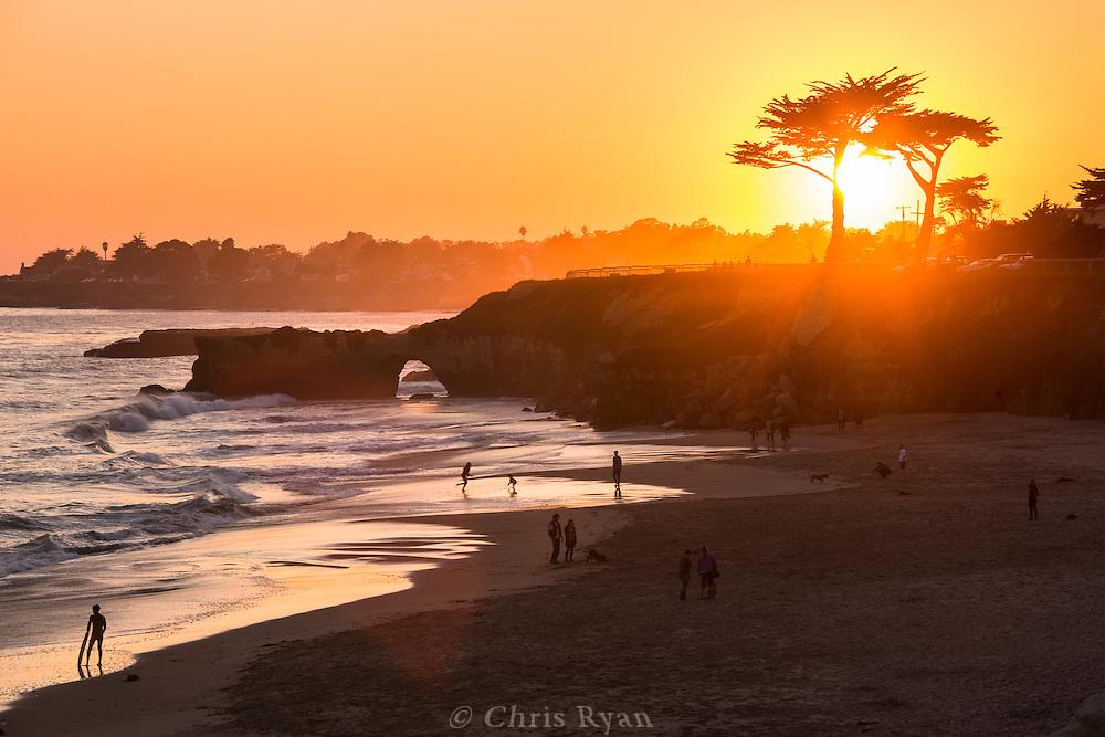 Kids playing on Its Beach at sunset, Santa Cruz, California