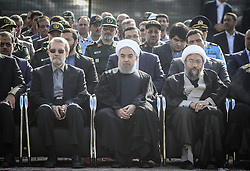 TEHRAN, Oct. 3, 2015 (Xinhua) -- Iranian President Hassan Rouhani (front C) attends a ceremony to pay tribute to 104 Iranian pilgrims killed in the latest Hajj stampede and transferred to Mehrabad airport in Tehran, capital of Iran, on Oct. 3, 2015. Rouhani on Saturday urged for an investigation into the latest Hajj stampede in Saudi Arabia which left 465 Iranian pilgrims dead. (Xinhua/Ahmad Halabisaz) (Credit Image: © Ahmad Halabisaz/Xinhua via ZUMA Wire)
