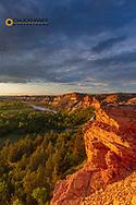 Dramatic light on cliffs over the Little Missouri River in the Little Missouri National Grasslands, North Dakota, USA