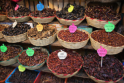 North America, Mexico, Oaxaca Province, Oaxaca, baskets with different varieties of peppers for sale in market
