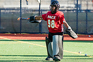 Pleasantville, New York - The Pace University goalie talks to teammates during warmups before playing Assumption College in the first round of the Northeast-10 Conference field hockey playoff game on Oct. 31, 2017.