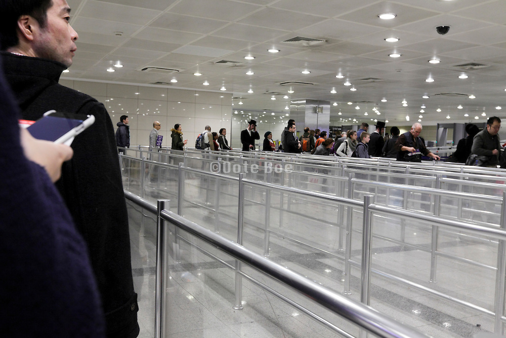 people waiting at border control and through travel entrance gate for non citizen at Istanbul Ataturk Airport Turkey