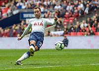 Football - 2018 / 2019 Premier League - Tottenham Hotspur vs. Arsenal<br /> <br /> Christian Eriksen (Tottenham FC)  strikes from close range at Wembley Stadium.<br /> <br /> COLORSPORT/DANIEL BEARHAM