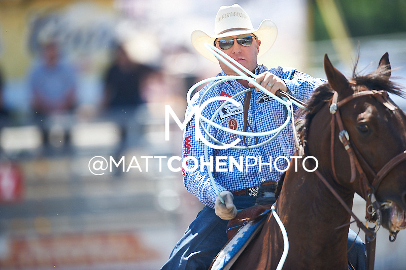 Team roper Brady Minor of Ellensburg, WA competes at the Redding Rodeo in Redding, CA.<br /> <br /> <br /> UNEDITED LOW-RES PREVIEW<br /> <br /> <br /> File shown may be an unedited low resolution version used as a proof only. All prints are 100% guaranteed for quality. Sizes 8x10+ come with a version for personal social media. I am currently not selling downloads for commercial/brand use.