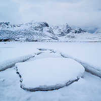 Snow covers sea ice in inner Flakstadpollen, Kilan, Flakstadøy, Lofoten Islands, Norway