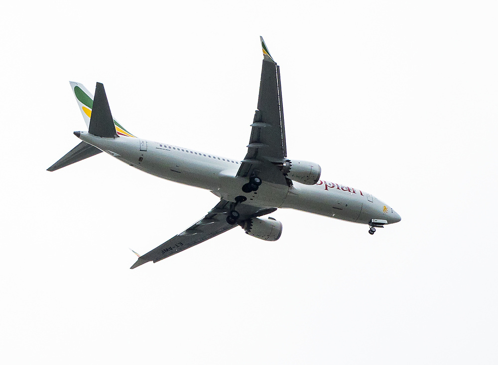 A Boeing 737 MAX 8 jet with Ethiopian Airlines markings lands at Seattle's Boeing Field, 042519.  With a few exceptions, Boeing 737 MAX jets are grounded worldwide following the crash of an Ethiopian Airlines MAX 8 in March, 2019, while work continues on a new flight control system, Maneuvering Characteristics Augmentation System (MCAS).