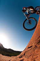 A freeride mountain biker rides slickrock in Sedona, Arizona.