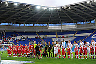 The teams line up for the anthems. Euro 2012 Qualifying match, Wales v Montenegro at the Cardiff City Stadium in Cardiff  on Friday 2nd Sept 2011. Pic By  Andrew Orchard, Andrew Orchard sports photography,